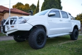 HILUX 4wd STYLESIDE UTE (vehicle with rear bumper step fitted) and OVERSIZE SPARE WHEEL